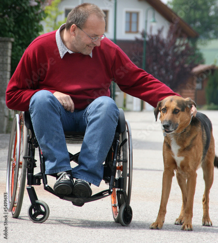 Man in a wheelchair with a dog