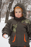 little boy with a snowball poster