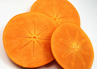 slices of fuyu persimmons, showing off their star pattern