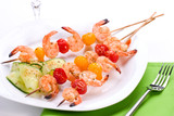 Dinner settiing of spicy grilled shrimps and basil tomato salad poster