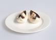 Split mushroom on a white plate
