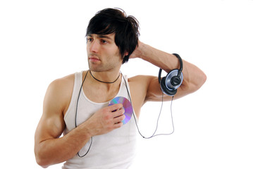 A young man in a t-shirt listening to music