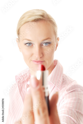 Close-up portrait of the blonde giving the lipstick