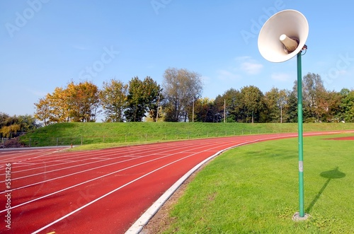 racetrack for runners and a speaker in the grass
