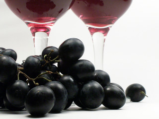 Brunch of  grapes on background with wineglasses