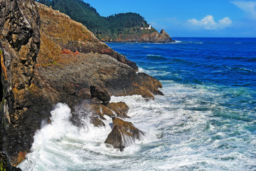 beautiful dramatic scenic image of the waves crashing