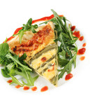 Asparagus quiche with salad and chili sauce