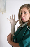 Nurse showing her gloved hand poster
