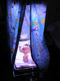 Newborn Baby with Jaundice Under Bilirubin Lights in Incubator