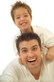 Young father and his toddler son playing around and laughing - Fine Art prints