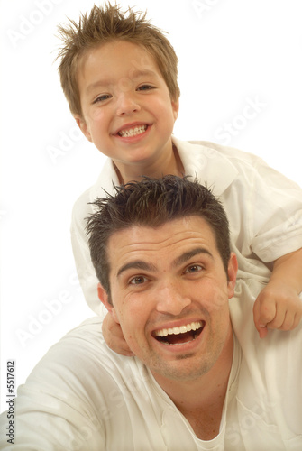 Young father and his toddler son playing around and laughing