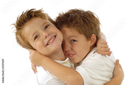 Two young boys playing around and laughing from joy