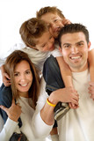 Attractive, modern young family hugging and laughing together