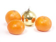 Christmas-tree decorations and tangerine on white  background