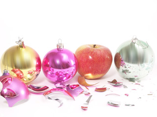 Christmas-tree decorations and apple on white  background