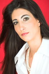 Beautiful young adult Italian businesswoman with black hair