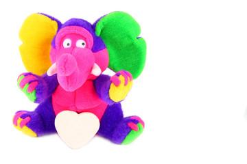 multicolored fluffy elephant with a shugar heart