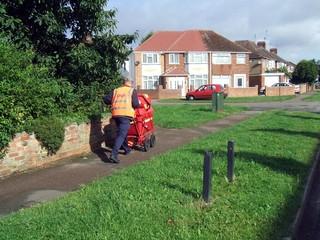 postman pushing his cart