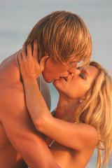 Young Woman holding her Man's face while kissing