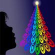 niña mirando arbol de colores en navidad