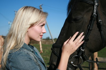 Blond female model with brown horse close-up portrait