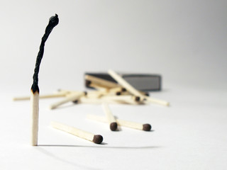Burnt match and matches