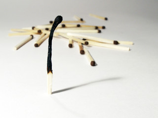 Lonely burnt match and matches