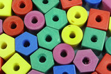 several colored foam beads make colorful background poster