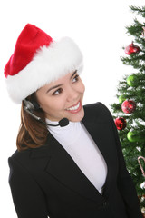 A pretty customer service business woman at Christmas