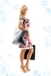lovely blond with shopping bags with snowflakes