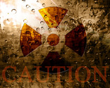 Worn nuclear sign with caution note poster