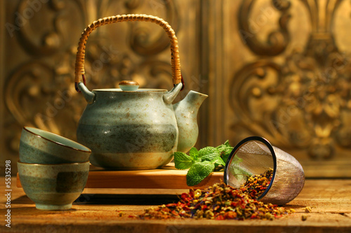 Poster Asian herb tea on an old rustic table