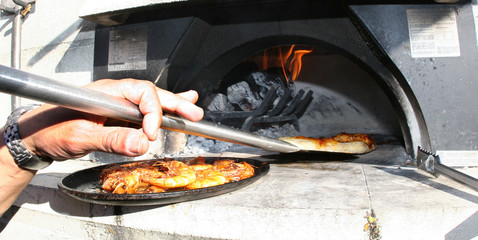 Making Pizza in a Wood Burning Oven