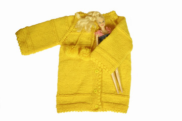 yellow cardigan and doll