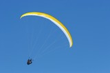 nice yellow parachute in the sky poster