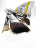 Close up to paint brush with acrylic paint tube poster
