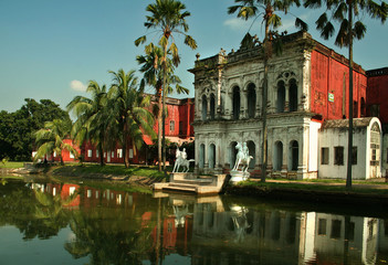 Sonargaon museum building with the reflection in the lake
