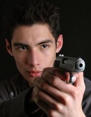 A man in the dark with a gun