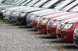 Постер, плакат: A row of brand new motorcars at a stockyard awaiting delivery