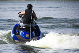 Image of a jet ski enthusiast in action. poster