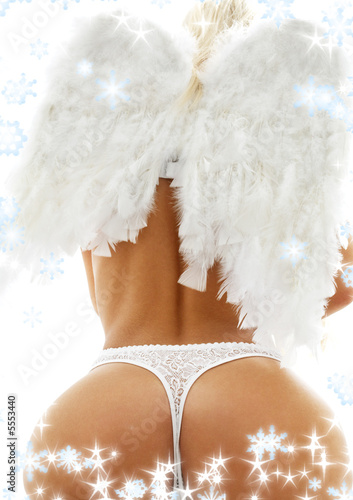 back of lady in white lingerie with angel wings and snowflakes - 5553440