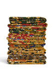 Isolated image of a stack of Batik Sarongs. poster