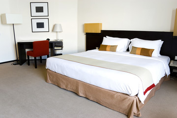 Image of a nice hotel bedroom.
