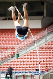 Image of a female pole vaulter in action.