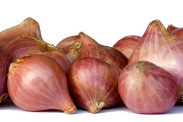 Isolated macro image of fresh red onions.
