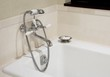 Clean, shiny bathtub and faucet