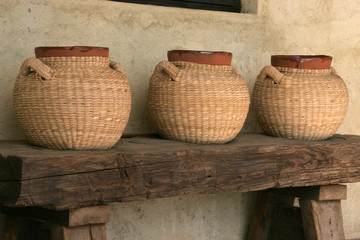Terra Cotta urns wrapped in Raffia, Baja, Mexico