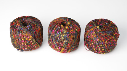 Three colorful yarn balls - red theme