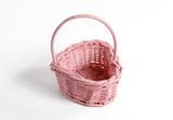 Woven pink basket on a white background. poster