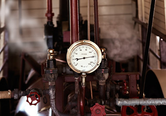 machinery under pressure gauge lets out steam